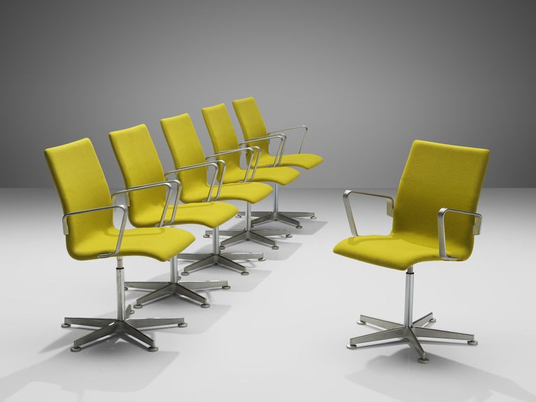 Arne Jacobsen for Fritz Hansen, set of 'Oxford' chairs, metal, yellow fabric, Denmark, design 1965, production later  These classic executive office chairs feature a medium high back (as opposed to the models with a low and a very high back), swivel