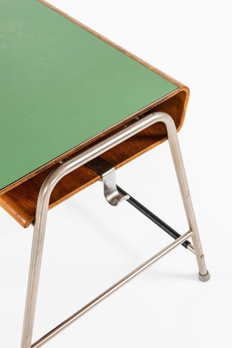 Rare Munkegaard school desk designed by Arne Jacobsen. Produced by Fritz Hansen in Denmark.