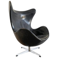 Arne Jacobsen for Fritz Hansen Patinated Black Leather Egg Chair,  Signed 1963
