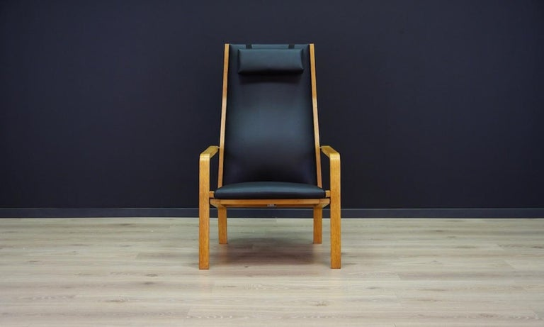 Armchair from the 1960s-1970s. Minimalist form designed by a leading Danish designer Arne Jacobsen. Beautiful straight line - model 4335 from manufactory Fritz Hansen. Armchair upholstered with the new Eko leather. Construction of ash wood. Armchair