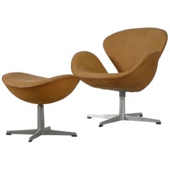 Arne Jacobsen Swan Chair and Ottoman, Newly Reupholstered in Tan Leather, 1964