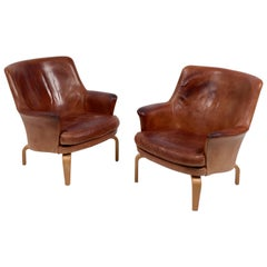 Arne Norell, a Pair of 'Pilot' Armchairs, Leather and Beech, Sweden, 1967
