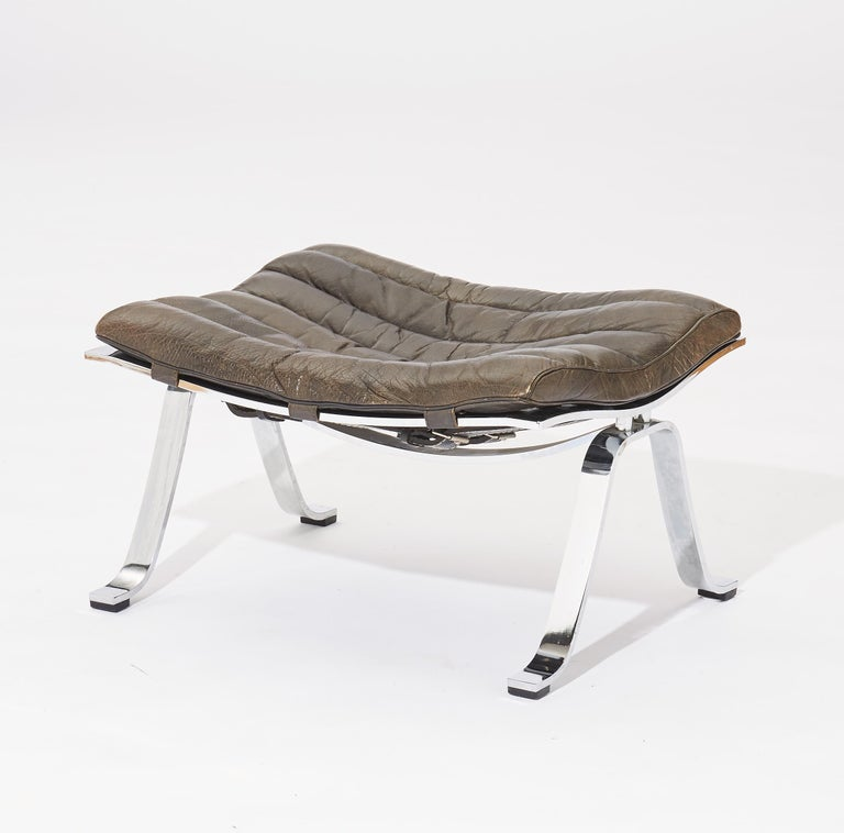 Black leather Ari lounge chair and ottoman, 1970s, Sweden, designed by Arne Norell for Norell Mo¨bel AB, Sweden. In nice original condition, with some fading and patina to the leather.   Measures: Chair: 74 cm high, 65 cm wide, 92 cm