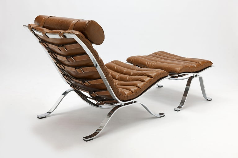 Vintage Ari lounge chair and ottoman with beautiful high gloss chrome steel frame designed by Swedish designer Arne Norell in 1966. One of the most timeless iconic and most comfortable designs of the 20th century. This vintage lounge chair and