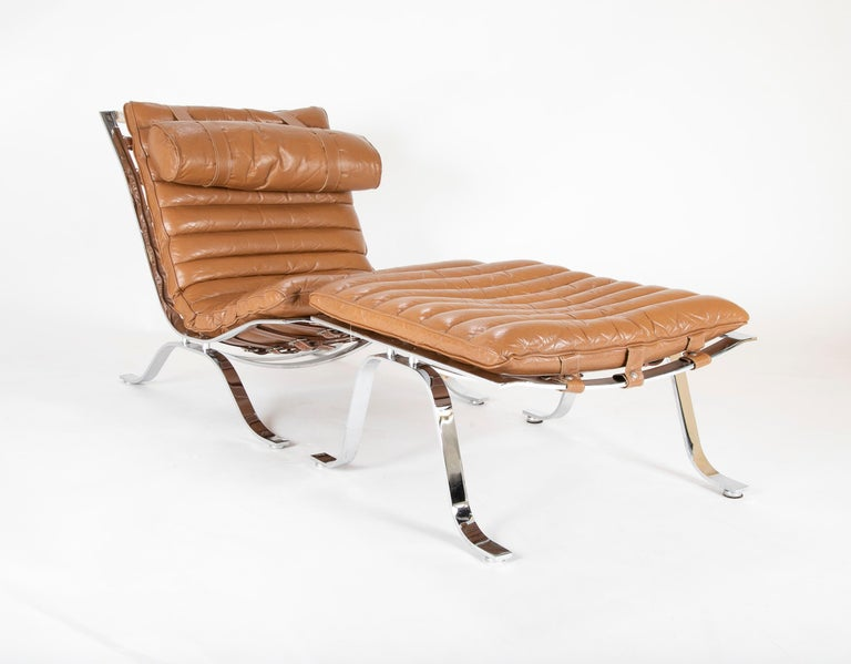 Chrome-plated steel and leather channeled cushion. Ari lounge chair with ottoman by Arne Norell,  circa 1966.