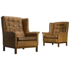 Arne Norell Matching Pair of High Back Chairs in Patinated Cognac Leather