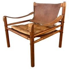 Arne Norell Sirocco Safari Chair in Rosewood-Colored Oak and Brown Leather, 1970