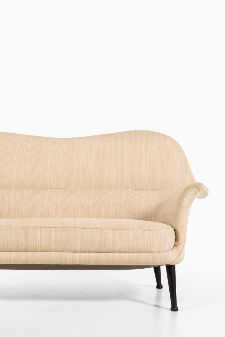 Sofa model Divina designed by Arne Norell. Produced by Westbergs Möbler in Sweden. Fabric with stains, would recommend to reupholster.