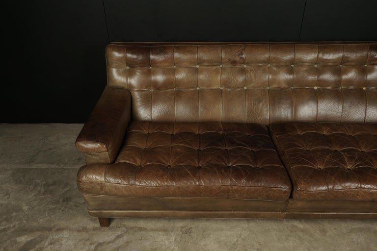 Arne Norell sofa model Merkur, Sweden, circa 1970. Original thick light brown leather upholstery. Very nice patina and wear.