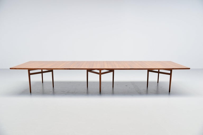 Monumental conference table model 201 designed by Arne Vodder and manufactured by Sibast Mobler, Denmark 1960. The table is made in teak wood, is fully restored and looks great again. Only 1 leg is a little bit bent, since this is solide wood we