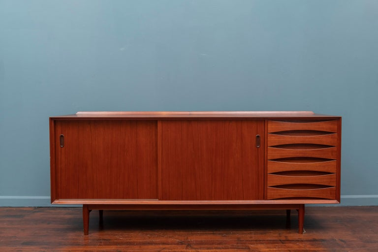 Arne Vodder design teak credenza Model 29 for Sibast Mobler, Denmark. High quality construction and attention to detail with two reversible sliding doors and adjustable shelves.  Very good condition with minor wear and signs of use to the top and