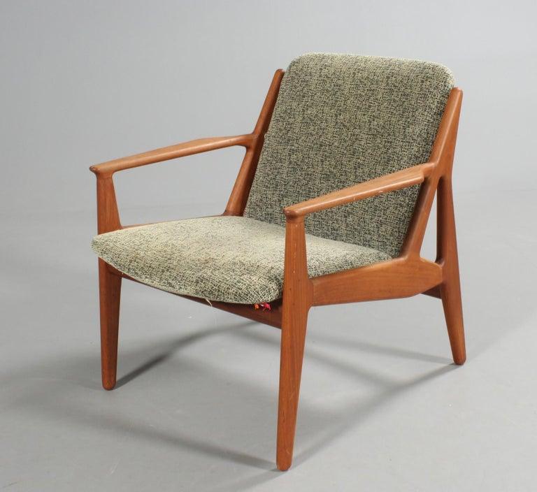 Origin: Denmark Designer: Arne Vodder Manufacturer: Vamo Møbler Era: 1960s Materials: Teak, wool Measurements: 28.5 wide x 32.5 deep x 31.5 tall  Condition: Frame in excellent original condition. Fabric and foam in original condition with