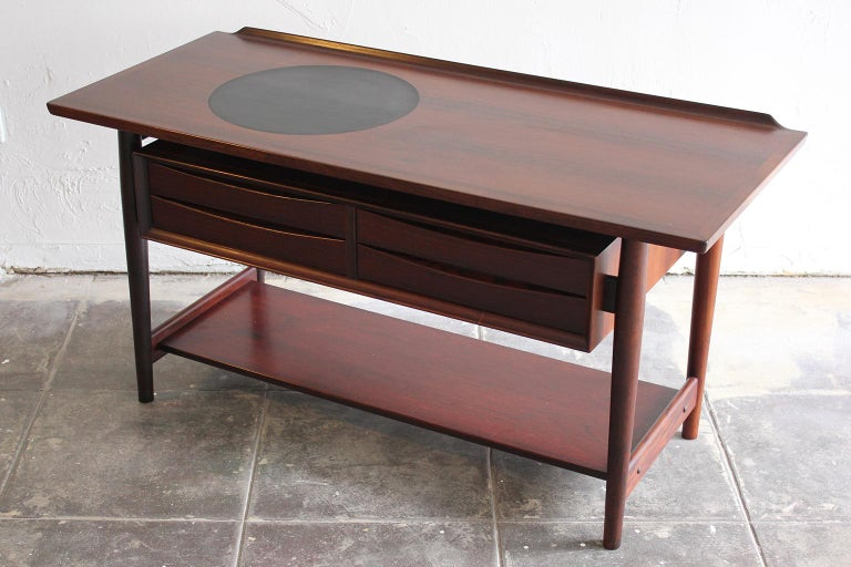 Beautiful Arne Vodder rosewood console/entryway table for Sibast. Modernist design with beautiful natural dark grain. Has been hand oiled and in very nice condition.