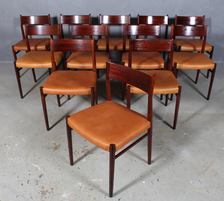 Arne Vodder dining chairs, new upholstered with tan vintage aniline leather.  Frame in partly solid rosewood.  Model 418, made by Sibast.