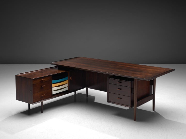 Arne Vodder for Sibast Møbler, executive corner desk, rosewood, Denmark 1950s.   This desk is executed in a dark tone rosewood. This luxurious piece was designed by one of the best designers Denmark has known and was produced by Sibast. Vodder