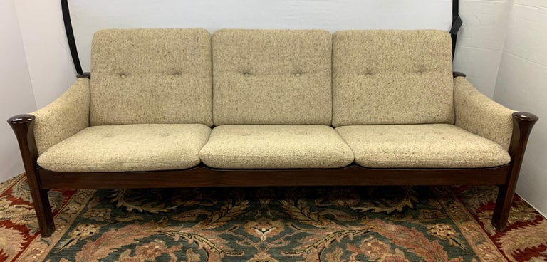 With its plinth shaped legs, bar reclining back, oatmeal tweed upholstery, and incredible lines, this signed Cado three-seat sofa by Arne Vodder is nothing short of exceptional. Made in Denmark and all original, it is still in great condition. An