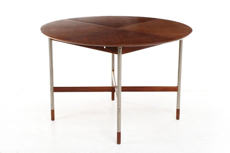 Fantastic small dining table attributed to Arne Vodder for Sibast, Denmark. Walnut top, X-form stretchers and sabots. Brushed stainless steel legs make for an unusual and eye-catching dining table for a breakfast nook or small dining room. We have