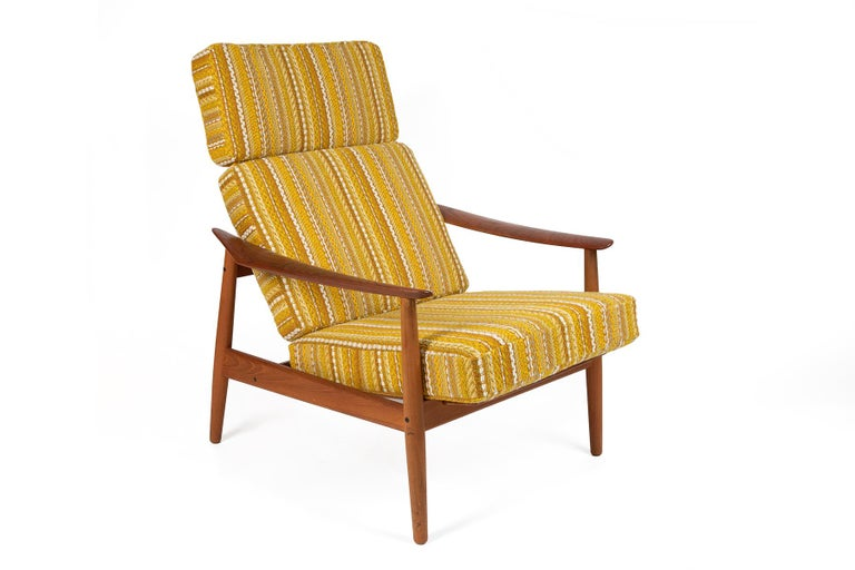 Arne Vodder reclining teak lounge chair and ottoman for France & Son. This has been newly upholstered in a 1960s Danish dead stock fabric. Ottoman dimensions: 15