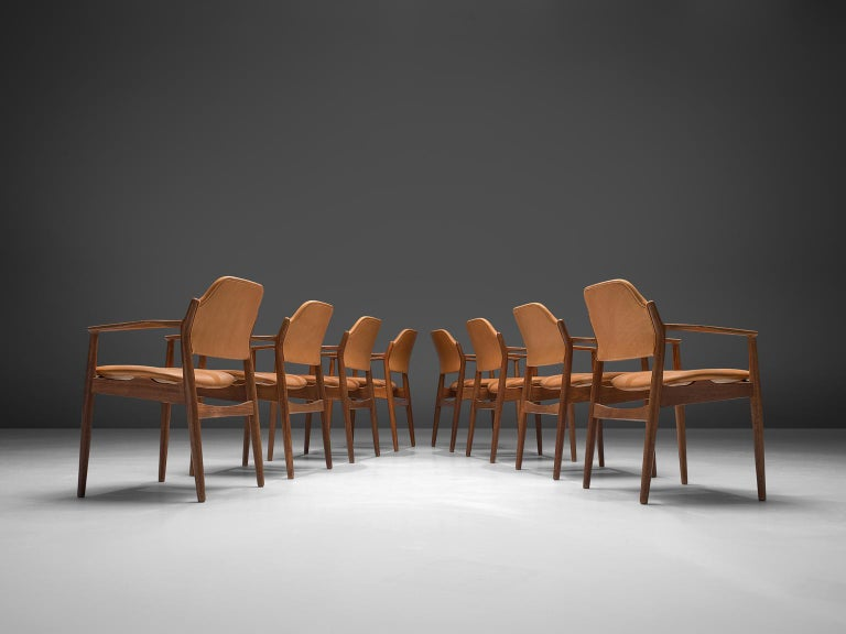 Arne Vodder for Sibast, set of 8 reupholstered dining chairs model 62A, rosewood and cognac leather, Denmark, 1960s.  This classic set of eight chairs is executed in leather and rosewood and designed by the Danish designer Arne Vodder. These