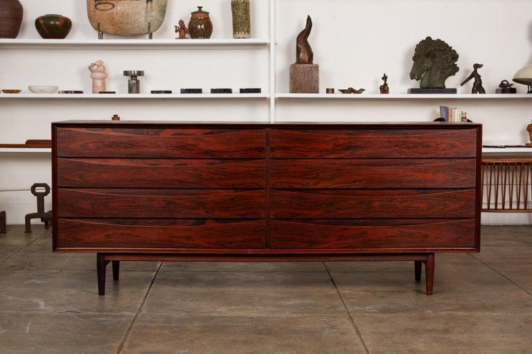 A striking rosewood dresser by Arne Vodder for Sibast Møbler, Denmark, circa 1950s. The eight-drawer double dresser from Vodder's