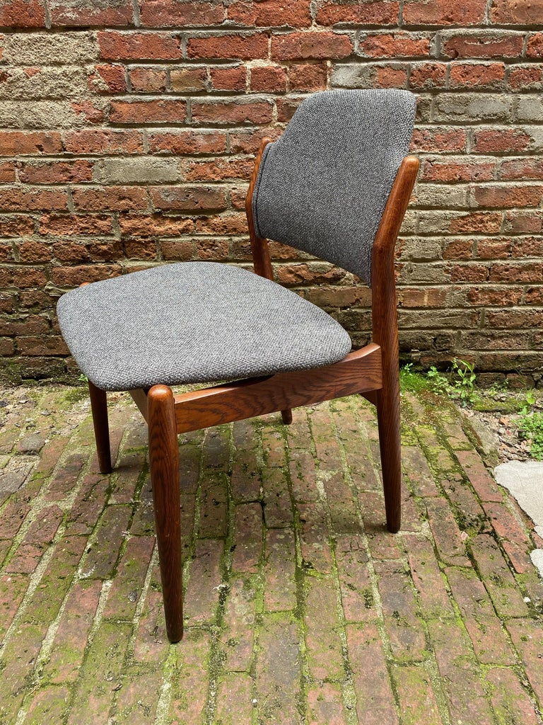 Arne Vodder for Sibast Møbler model #62 oak side chair. Solid oak frame with newly upholstered nubby gray fabric. Structurally sound and sturdy chair. Signed under the seat, Made in Denmark, George Tanier Selection, Sibast Mobler. 
