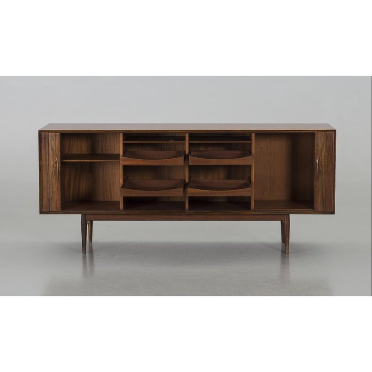 A sideboard of model 75 designed by the Danish designer Arne Vodder and produced at Sibast Møbelfabrik in Denmark. The sideboard was designed probably in the late 1950s-in the early 1960s. The sideboard is made in Brazilian rosewood and comes with a