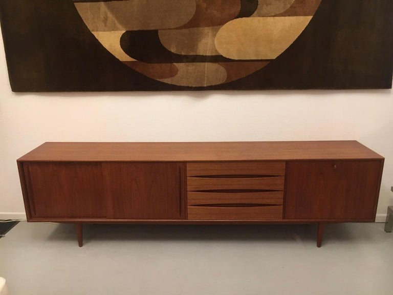 Arne Vodder teak sideboard produced by Pfister Mobel Switzerland, circa 1960.