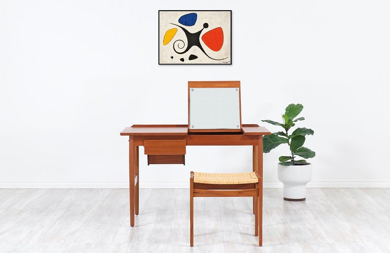 One of our most functional and stylish desk that doubles as a vanity designed by Arne Vodder for the workshop of Sibast Møbler in Denmark during the 1950s. Our elegant Scandinavian writing desk is constructed from a solid teak frame with a stunning
