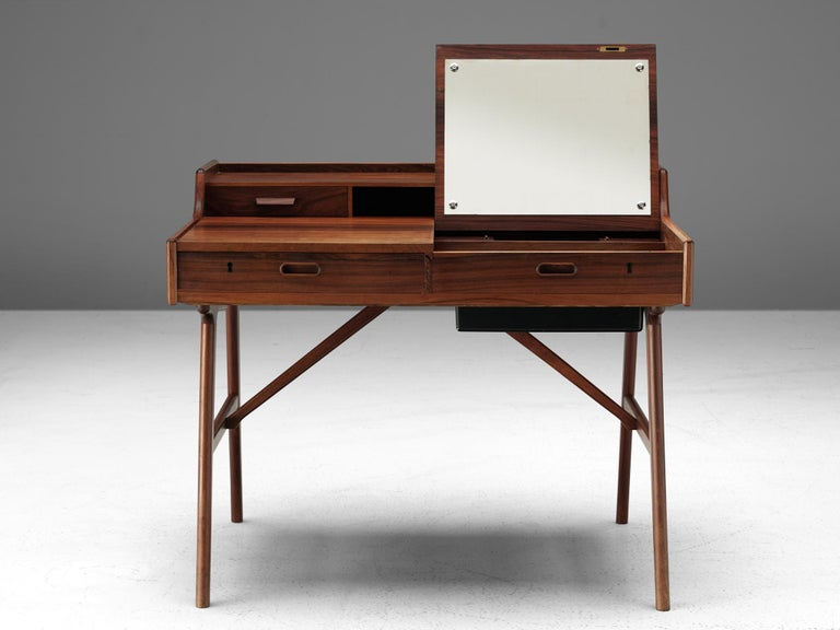 Arne Wahl Iversen for Vinde Møbelfabrik, Desk model 65, rosewood, Denmark, circa 1961.  Refined and excellent writing table by Danish designer Arne Wahl Iversen. This small writing table has a beautiful open look due the high tapered legs. The