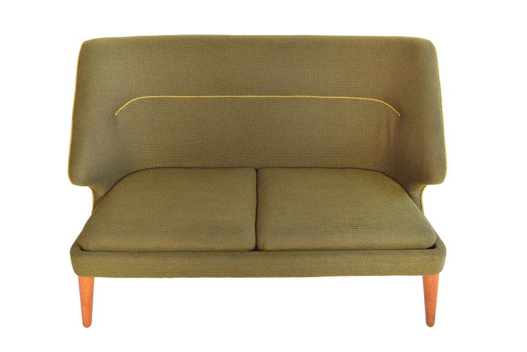This rare Danish modern loveseat was designed by Arne Wahl Iversen as the 'Flamingo' sofa, Model 15, for Hans Hansen in 1955. Beautifully preserved and completely original, this cozy loveseat offers a tall back and dramatic profile. Solid canted
