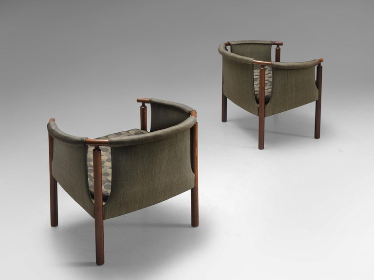 Arne Wahl Iversen for Poul M. Jessen, pair of rosewood armchairs 293/3 with green fabric, Denmark, 1950s.  This set of armchairs is upholstered with green fabric. The inventiveness of this chair lies in the open spaces next to the rosewood frame.