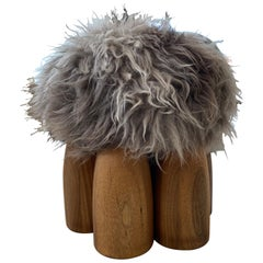 Arno Declercq Senufo Ottoman in Natural African Walnut with Gray Brown Sheepskin