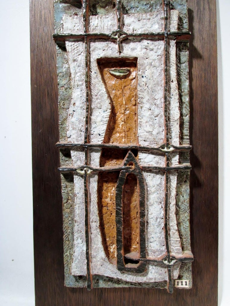 "1950s era abstract ceramic still life wall plaque sculpture. From renowned Cape Cod Massachusetts artist Arnold Geissbuhler. Measures: 16.5"" x 7.5"" plaque attached to 20"" x 11"" plywood backing board."