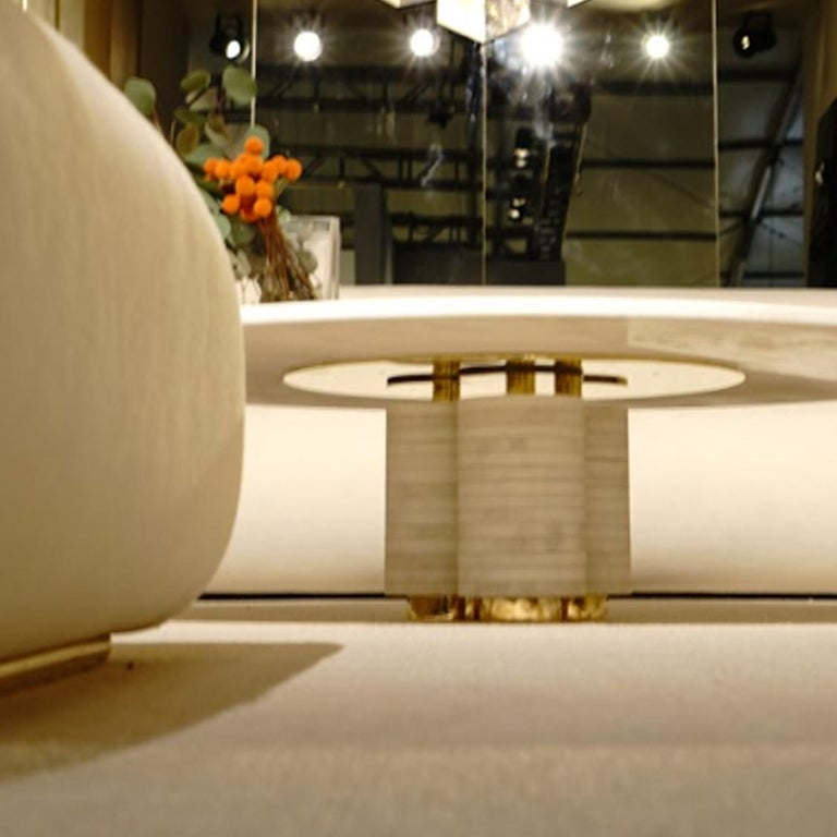 The Aro coffee table is a white Rhino Quartz marble tabletop with marble ringed base and brass details.   The aesthetic of this piece comfortably straddles the line between art and functionality, a philosophy that has drawn inspiration from