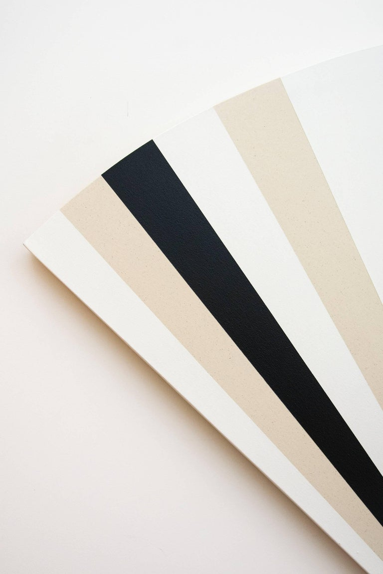 Aron Hill's paintings consist of layers of acrylic ink washes on clear primed raw canvas. This hard edge, black, white and raw canvas painting is particularly sculptural as it is painted on a fan shaped stretcher, and with a repetitive pattern