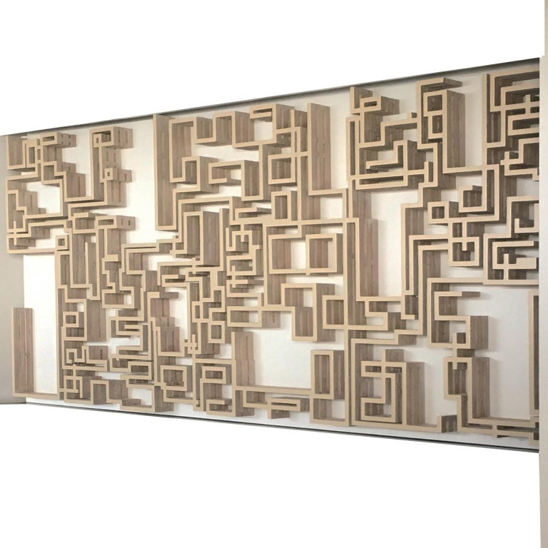 This piece was carefully made following labyrinth patterns in the heart of Mexico City. It is handmade with wooden pieces and assembled. It can be used to place ornaments or collection pieces. The three layers give it a 3d feeling. It has a