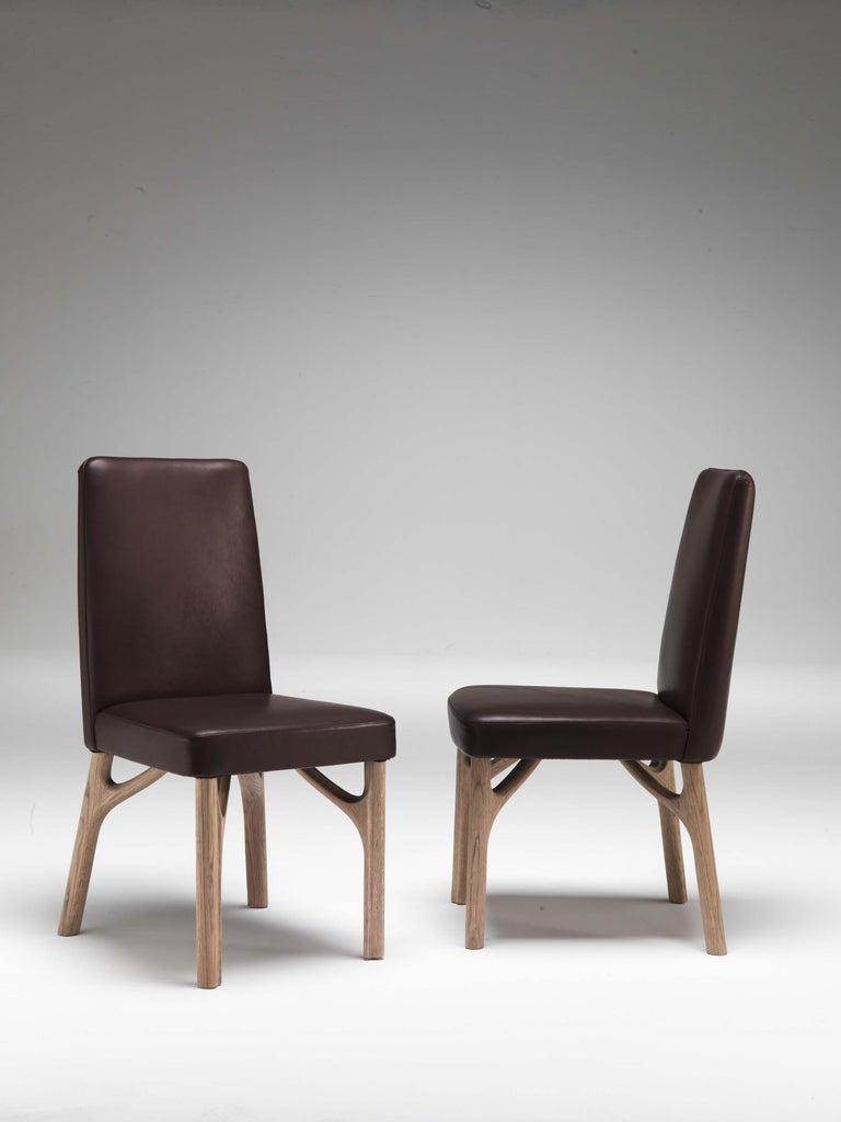 Dining chair in leather art. Acquario.  Dimensions: Dia. 48 W x 56 D x 93 H cm, SH 49 cm.  This item has been individually handmade by our master craftsmen. Any irregularities or natural blemishes should not be misconstrued as flaws but as integral