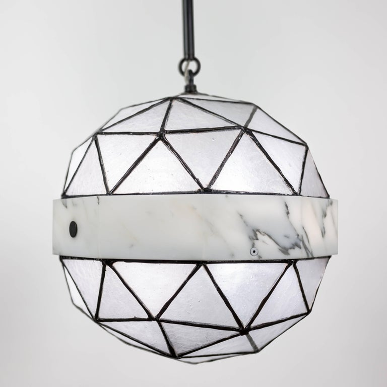 Array is a single pendant in Carrara marble and glass made to order by Kalin Asenov studio. 
