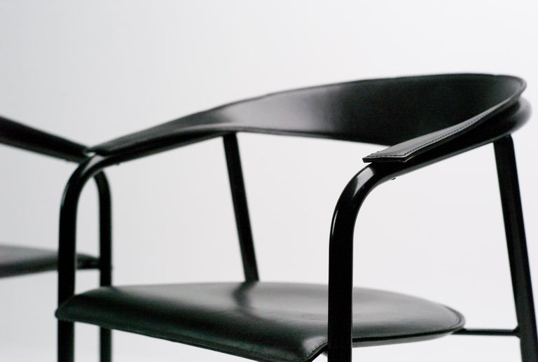 These slope-backed armchairs were created by Arrben in the 1980s. 