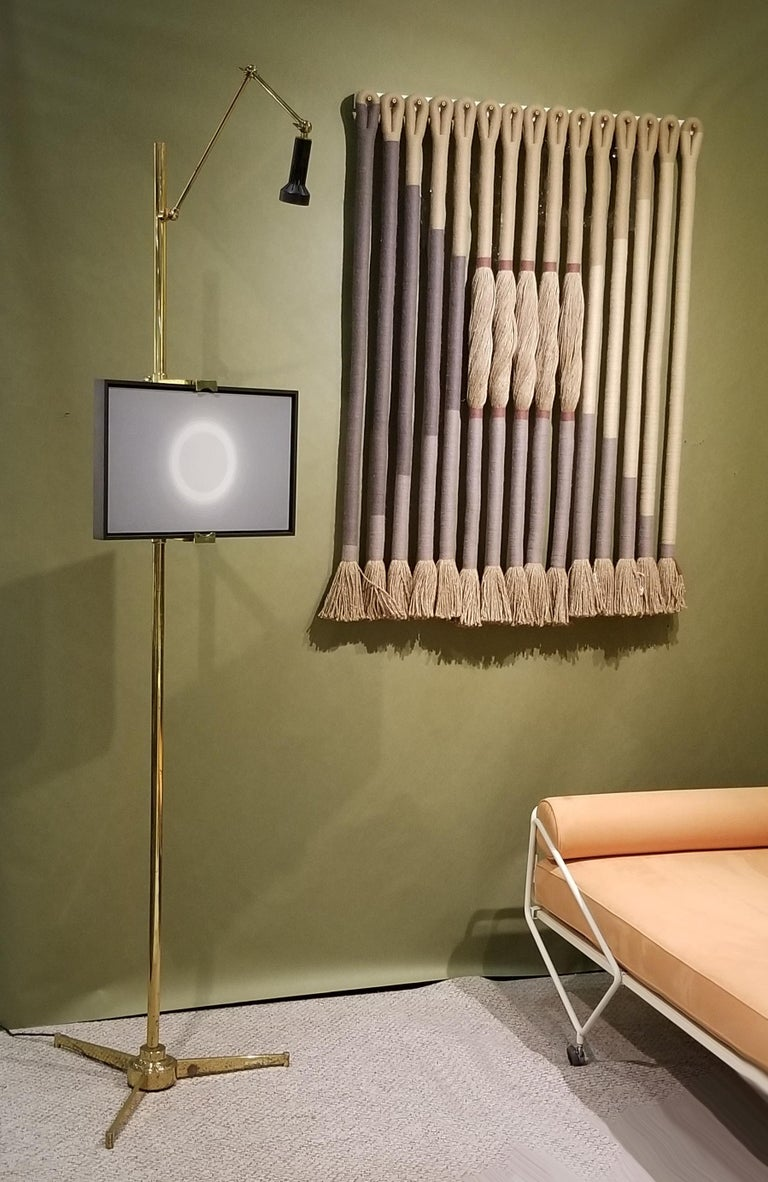 All original example of the Arredoluce Easel lamp. This is the more desirable version with the elegantly tapering tripod base. This example retains the original label to the underside of the fixture and the original foot switch works as intended.