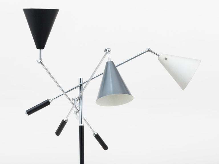 Marble-based version of the iconic three-arm design from the Milan Triennale of 1951. Features three different colored enameled metal shades in black, grey and white, along with leather handle grips and chrome-plated, articulating arms. Dimensions