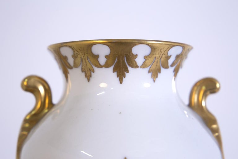 Precious Italian vase from the 1950s made by the great silversmith Arrigo Finzi. The vase is made in fine porcelain. Its great elegance and preciousness is given by its working in pure gold foliage and floral ornaments, and the large decorative