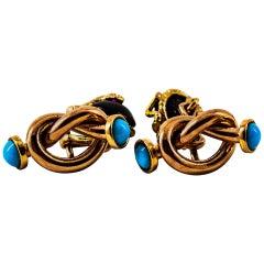 "Art Deco 0.08 Carat Ruby Turquoise Onyx Yellow Gold ""Knot"" Cufflinks"