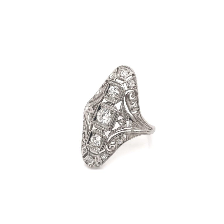 This antique piece was handcrafted sometime during the Art Deco design period ( 1920-1940 ). The very popular Art Deco dinner ring is often considered the predecessor to the notable Mid Century cocktail ring. This dinner style ring features 15