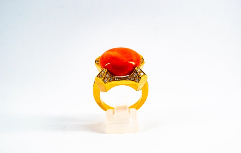 This Ring is made of 14K Yellow Gold. This Ring has 0.60 Carats of White Diamonds. This Ring has Mediterranean (Sardinia, Italy) Peach Coral. Size ITA: 19 Size USA: 8.5 We're a workshop so every piece is handmade, customizable and resizable.