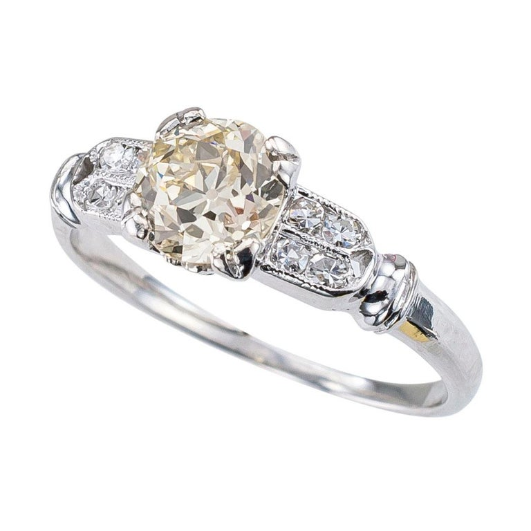 Art Deco 0.70 carat old European cut diamond lite yellow color VS clarity diamond solitaire and platinum engagement ring circa 1930 ring size 4 ¾.  This is a genuine Art Deco diamond engagement ring with which you can impress that special lady in