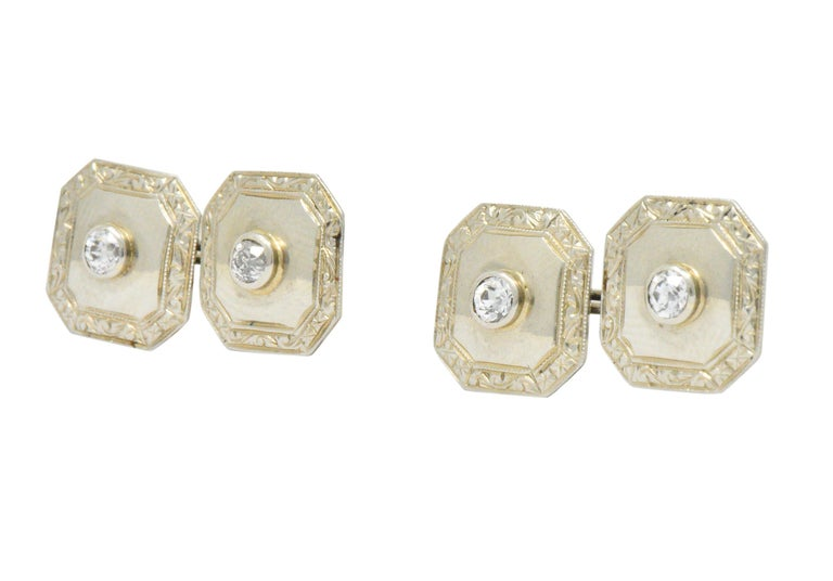 Each centering old European cut diamonds, four total weighing approximately 0.72 carat total, G/H color and VS2-SI2 clarity  Cut-corner square form with miligrain edge and scroll work border link style cufflinks  Tested as 18k gold  Measures: 1/2 x