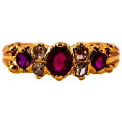 Art Deco 0.75 Carat White Rose Cut Diamond Oval Cut Ruby Yellow Gold Band Ring