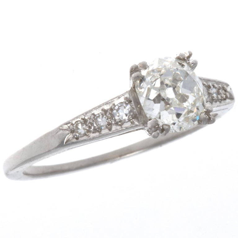 If Scott Fitzgerald's novels make your heart beat faster, and social gatherings brighten your day, then this Art Deco diamond platinum ring is for you. Art Deco, a time of elegance, cocktails, and night clubs. All captured in this very elegant ring.