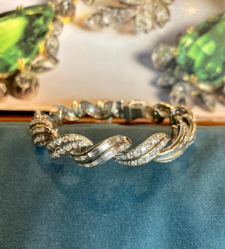 A beautiful Art Deco bracelet featuring 10 carats of round brilliant and baguette cut diamonds mounted in 18 karat white gold. Measures 6.5 inches long. Made in France, circa 1920s.